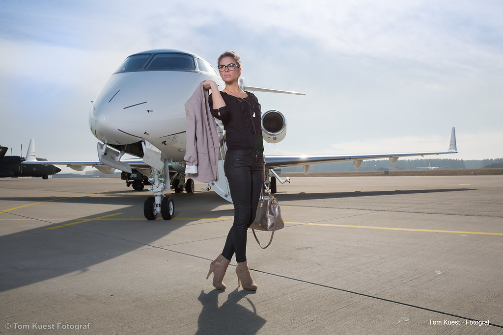A executive business woman leaving a plane (BL5C0071) | A executive business woman leaving a plane | air, airplane, airport, arrival, bag, baggage, beautiful, business, businesswoman, caucasian, corporate jet, ececutive, female, flying, girl, handsome, happy, international, jet, journey, lady, leaving, legs, leisure, manager, modern, one, passenger, people, person, plane, professional, standing, terminal, travel, traveler, trip, woman, young