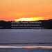 Starnberger See frozen in winter (B120222_9302 - Kopie) - Muensing, Germany, February 22, 2012 frozen starnberger see in bavaria with orange sundown