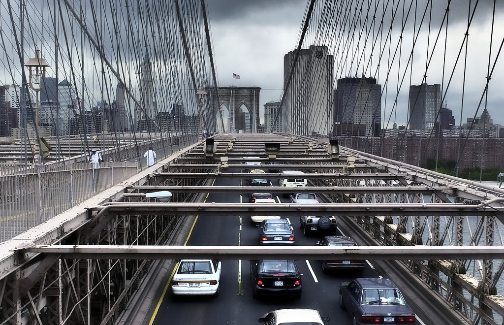 Brooklyn Bridge (Brooklyn Bridge) | Standing on Brooklyn Bridge high angle view on traffic | New York, Brooklyn Bridge, traffic, cars, walkers, Skyline, cloudy, steel construction, rear lights, vehicles, symmetric