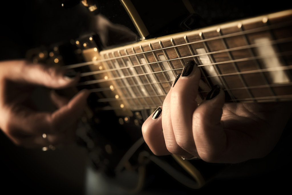 Guitarplayer (Guitarplayer) | Close up view on a musican hand playing guitar | guitar, strings, hand, nails, sepia, close up, black, fingers, music, musican, monochrome, hands