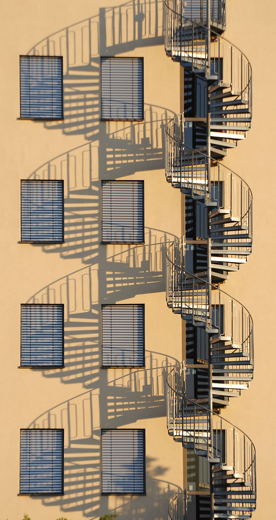 Spiral Staircase (Spiral Staircase) | Symmetrical by repetition in warm sunlight of a spiral staircase | spiral, staircase, shadow, light, sunny, house, architecture, symmetrical