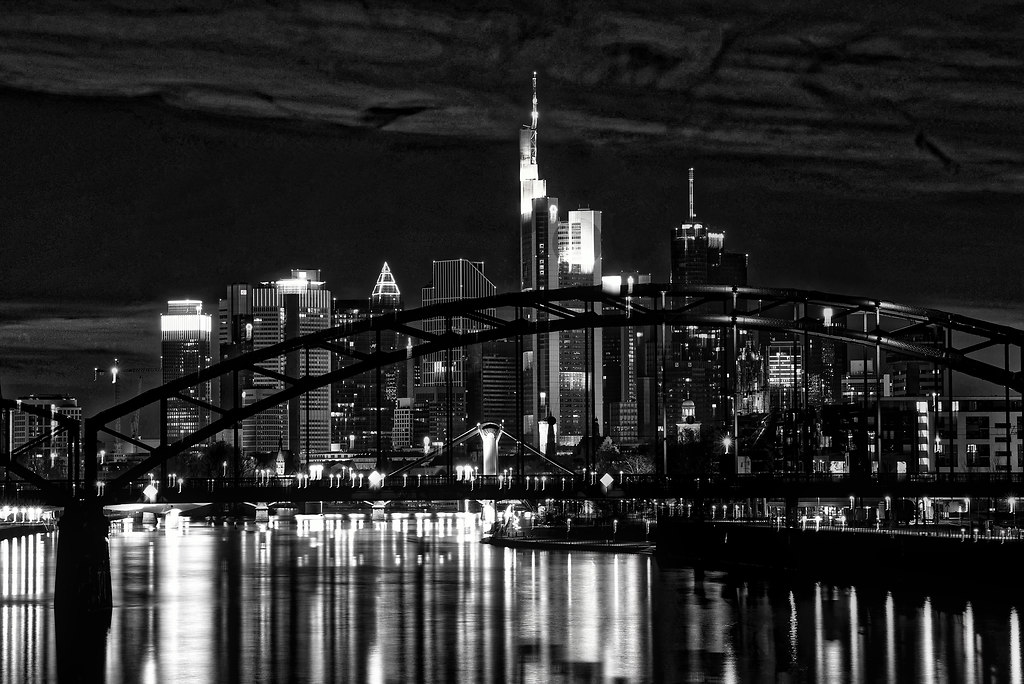 Frankfurt Skyline (Skyline) | Frankfurt Skyline with river reflections black and white modern | monochrome, city, architecture, reflection, bridge, travel, building, skyscrapers, water, river, urban, light, black and white, horizontal, modern