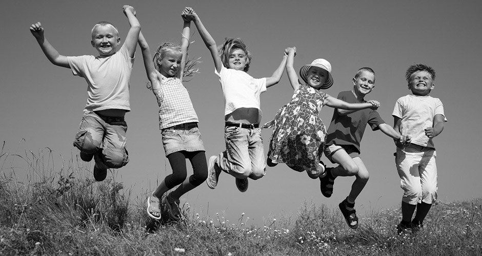 Happy childhood (kinder springen sw) | Group  happy children  jumping on summer meadow against blue sky | children, jump, kids, summer, friends, happiness, team, together, boy, casual, caucasian, cheerful, childhood, company, cute, education, expression, face, family, friendship, fun, girl, glad, group, happy, horizontal, lad, lifestyle, natural, offspring, outdoors, outside, people, person, positive, preschooler, school, schoolboy, schoolgirl, vacation, holiday, season, several, smiling, youngster, youth, youthful, relationships, grass, green, sky, blue